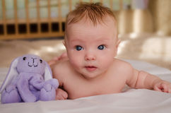 Naked baby with a toy Royalty Free Stock Image