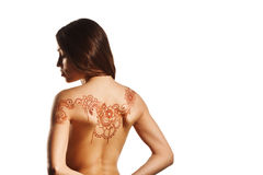 Naked back of young girl with henna mehendi. On white backround royalty free stock photos