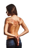 Naked back of young girl with henna mehendi Royalty Free Stock Images