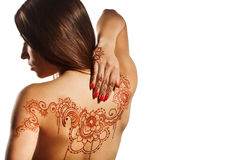 Naked back of young girl with henna mehendi. On white backround stock photos