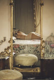 Naked beautiful young  female  on the bed in a large mirror Stock Image