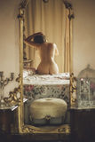 Naked beautiful young  female  on the bed in a large mirror Stock Images