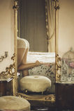 Naked beautiful young  female  on the bed in a large mirror Stock Photography