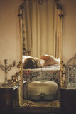 Naked beautiful young  female  on the bed in a large mirror Royalty Free Stock Photo