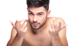 Naked beauty man welcomes you for a talk. Young naked beauty man welcomes you for a talk on white background Royalty Free Stock Images