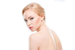 Naked blonde woman looking at camera on white, body care concept. Gorgeous naked blonde woman looking at camera on white, body care concept Royalty Free Stock Photography