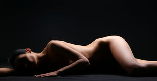 Naked body of a young and beautiful woman Royalty Free Stock Photo