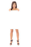 Naked brunette holding a blank sign Stock Photo