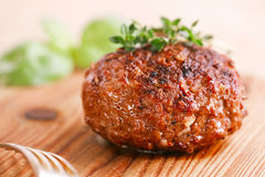 Naked burger on wooden plate Royalty Free Stock Images