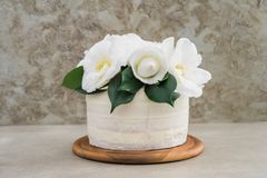 Naked wedding cake with camellias Stock Photo