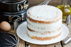 Naked cake with cheese frosting. Cooking process stock images