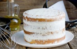 Naked cake with cheese frosting. Cooking process royalty free stock photography