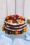 Naked cake with cream. Decorated with berries stock photography