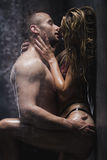 Naked couple kissing in the shower Royalty Free Stock Image