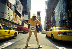 Naked Cowboy, Dollar Business 9_13. Man wearing underwear and Cowboy hat and boots, playing Guitar among traffics on Times Square stock image