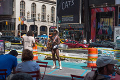 The Naked Cowboy. New York, NY USA -- Aug 3, 2016 -- Barely dressed cowboy plays guitar and sings for tourists in Times Square. Editorial Use Only Royalty Free Stock Image