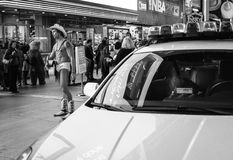 Naked Cowboy, Times Square, New York. Black and white art image of the Naked image and a police car in Times Square on a typical busy evening in Manhattan, New Stock Images