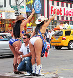 Naked Cowgirls. Posing with a tourist for a photo in Times Square in Manhattan,NY Royalty Free Stock Image