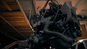 Naked Engine Car Suspended in the Garage stock video footage