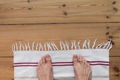 naked feet on carpet Royalty Free Stock Image