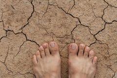 Naked feet on dry land Royalty Free Stock Photos