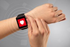 Hand with smartwach and helath concept. Naked female hand with smartwatch and with heart rate icon on the watch Stock Images