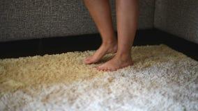 Naked female legs on the carpet