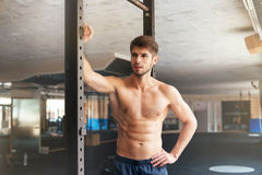 Naked fitness man in gym. Looking away royalty free stock photo