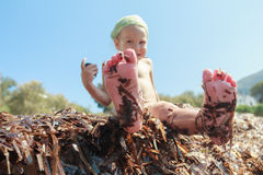 Naked foot soles covered by Neptune grass leaves Stock Image