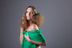 Naked girl hide with cloth - camomile in hairs Royalty Free Stock Image