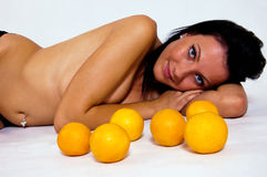 Naked girl and oranges Royalty Free Stock Images