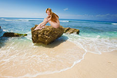 The naked girl on a stone Royalty Free Stock Photo