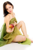 Naked girl in the tissue with an apple Stock Photography