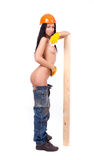 Naked girl in the working pants Royalty Free Stock Photos