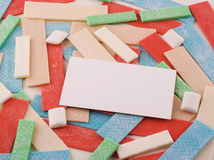 Naked gum with blank business card. A background of various sticks and pieces of gum support a blank white business card stock photo