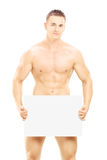 Naked guy holding a blank panel Stock Photography