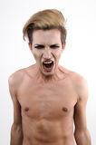 Naked homosexual guy screams in pain Royalty Free Stock Photos