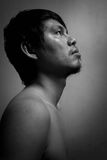 Naked hopeless man looking up. In white tone Royalty Free Stock Photos