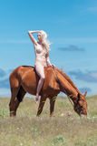 Naked horsewoman Stock Images