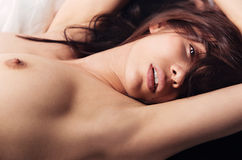 Naked hot girl on the bed Royalty Free Stock Images