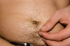 Naked male belly with fat stock image