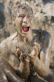 Naked man. Covered in mud Stock Image