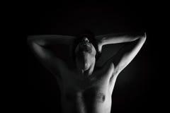 Naked man with bandage on eyes. Young naked man with bandage on eyes stock photo