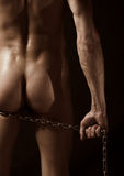 Naked man with chain Stock Image