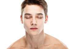 Naked man closed eyes. Close-up portrait of young handsome man with closed eyes isolated on white background stock images