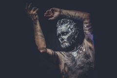 Naked man covered with paint and mud skin Royalty Free Stock Photos