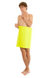 Naked man covering oneself yellow card Stock Photos
