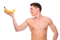 Naked man with fruit. Full isolated studio picture from a young naked man with banana Stock Images