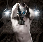 Naked Man with gas mask on background of robots and technology Stock Photo