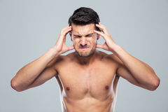 Naked man having headache Royalty Free Stock Photos